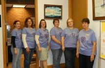 Our Tellers and Receptionist painting the town Purple with our Cancer Awareness t-shirts!